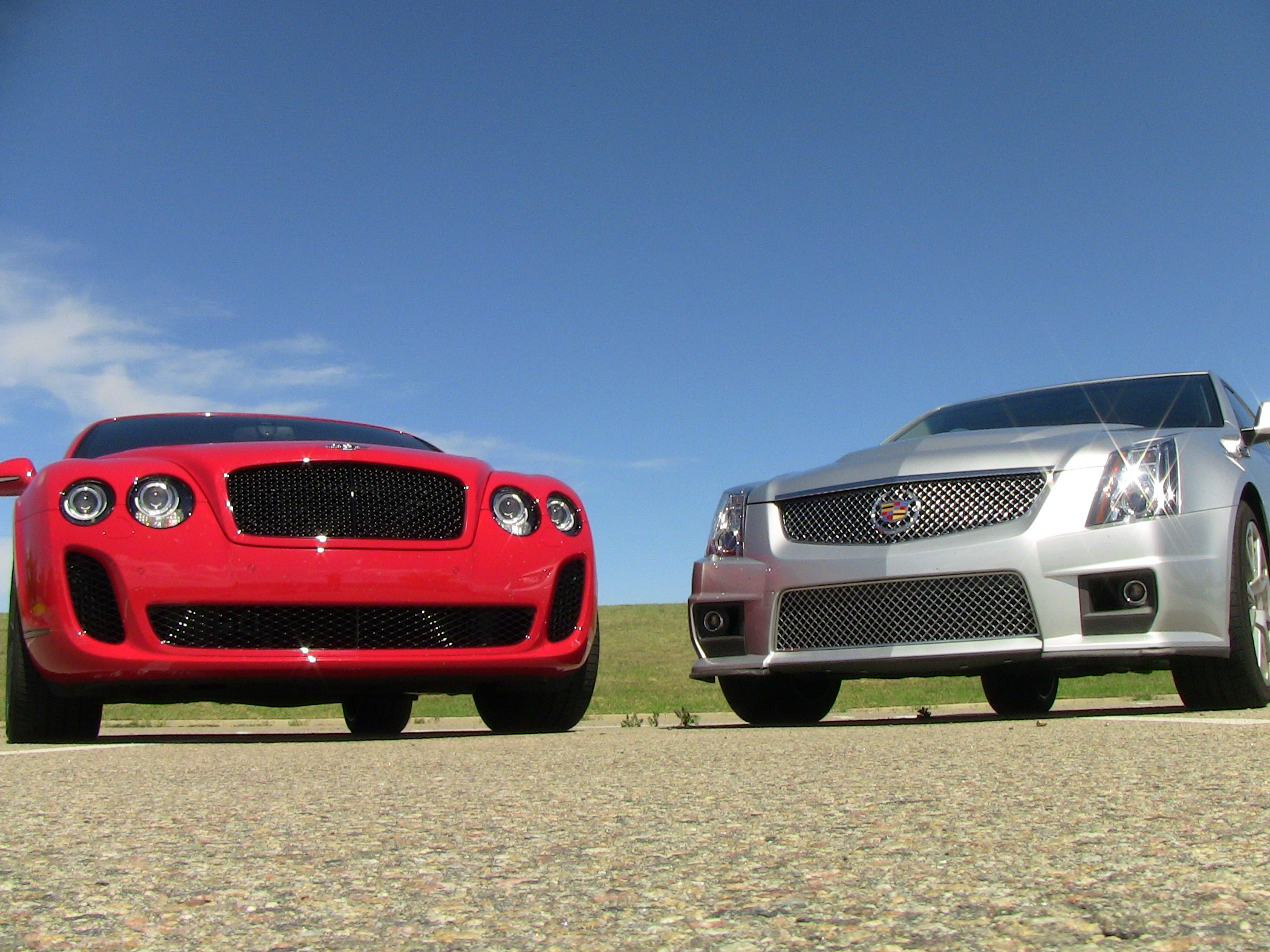 Video Drag Race 2010 Bentley Continental Supersports Vs Cadillac