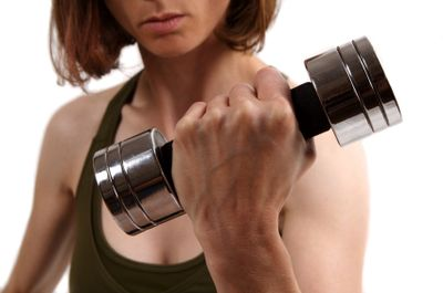 Lady-strength-training-with-dumbell